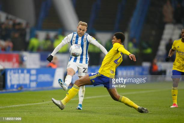 Alex Pritchard of Huddersfield Town and Jude Bellingham of Birmingham City during the Sky Bet Championship match between Huddersfield Town and...