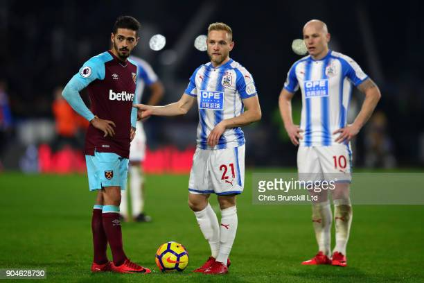 Alex Pritchard of Huddersfield Town and Manuel Lanzini of West Ham United stand over the ball during the Premier League match between Huddersfield...