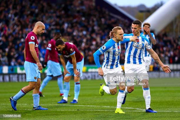 Alex Pritchard of Huddersfield Town celebrates after scoring a goal to make it 10 during the Premier League match between Huddersfield Town and West...