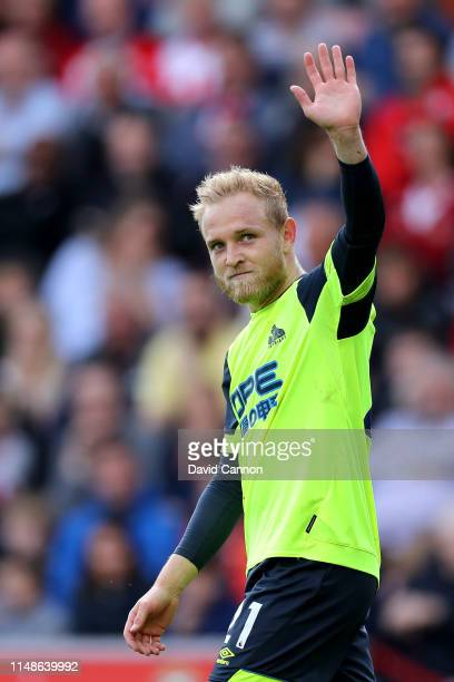Alex Pritchard of Huddersfield Town celebrates after scoring his team's first goal during the Premier League match between Southampton FC and...