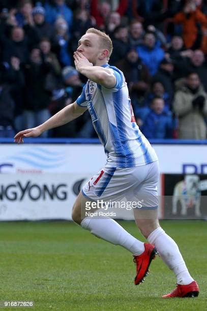 Alex Pritchard of Huddersfield Town celebrates after scoring his sides first goal during the Premier League match between Huddersfield Town and AFC...