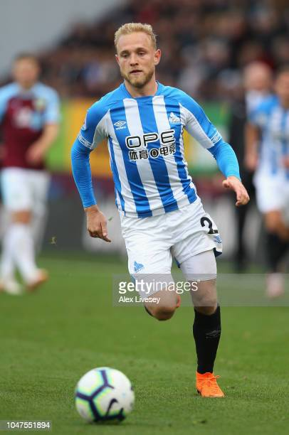 Alex Pritchard of Huddersfield Town chases the ball during the Premier League match between Burnley FC and Huddersfield Town at Turf Moor on October...