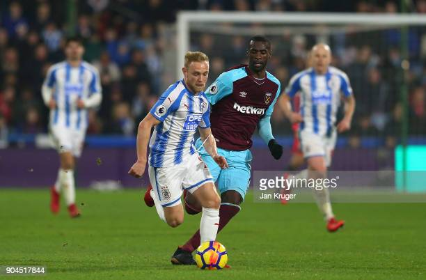 Alex Pritchard of Huddersfield Town controls the ball from Pedro Obiang of West Ham United during the Premier League match between Huddersfield Town...