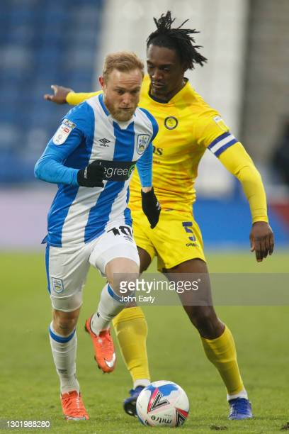 Alex Pritchard of Huddersfield Town dribbles past Anthony Stewart of Wycombe Wanderers during the Sky Bet Championship match between Huddersfield...