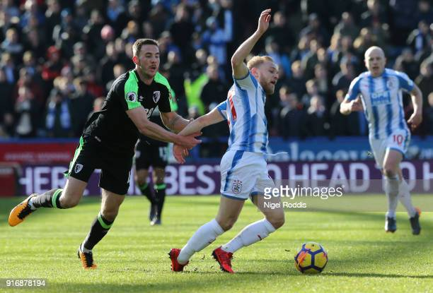 Alex Pritchard of Huddersfield Town is challenged by Dan Gosling of AFC Bournemouth during the Premier League match between Huddersfield Town and AFC...