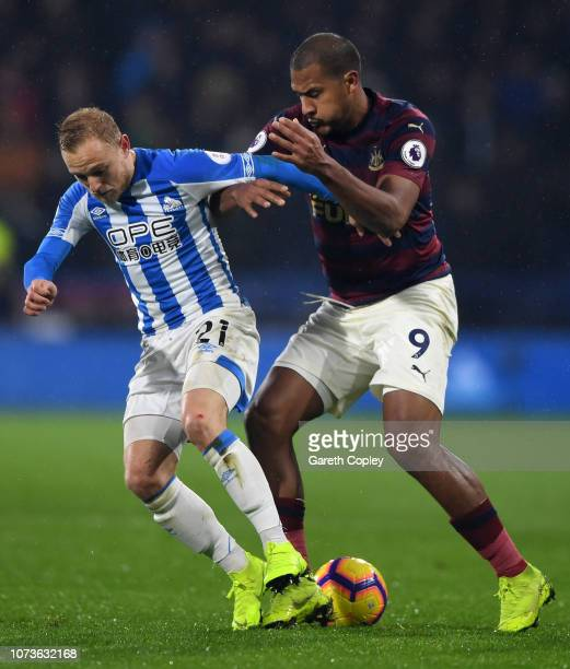 Alex Pritchard of Huddersfield Town is challenged by Salomon Rondon of Newcastle United during the Premier League match between Huddersfield Town and...