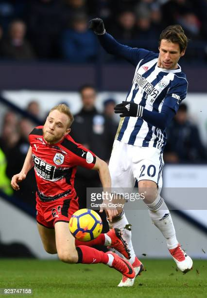 Alex Pritchard of Huddersfield Town is fouled by Grzegorz Krychowiak of West Bromwich Albion during the Premier League match between West Bromwich...