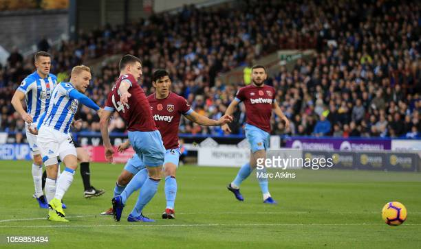 Alex Pritchard of Huddersfield Town scores his team's first goal during the Premier League match between Huddersfield Town and West Ham United at the...