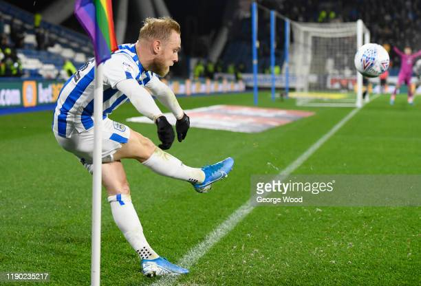 Alex Pritchard of Huddersfield Town takes a corner next to rainbow corner flag during the Sky Bet Championship match between Huddersfield Town and...