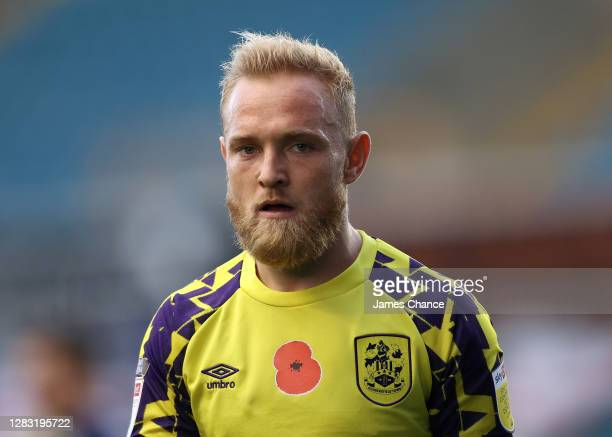 Alex Pritchard of Huddersfield Town wears a shirt with the Poppy on silence in honour of Armistice Day during the Sky Bet Championship match between...