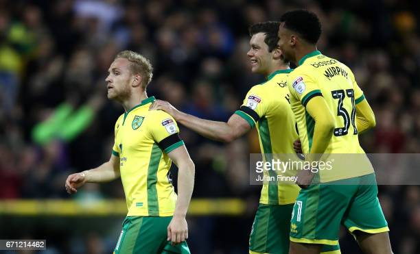 Alex Pritchard of Norwich City celebrates with team mates after David Stockdale of Brighton and Hove Albion scores an own goal during the Sky Bet...