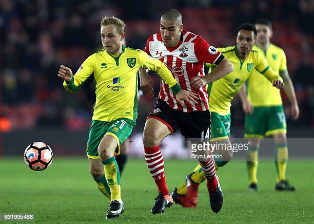 Alex Pritchard of Norwich City is challenged by Oriol Romeu of Southampton during The Emirates FA Cup Third Round Replay match between Southampton...