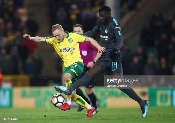 Alex Pritchard of Norwich City is challenged by Tiemoue Bakayoko of Chelsea during the The Emirates FA Cup Third Round match between Norwich City and...
