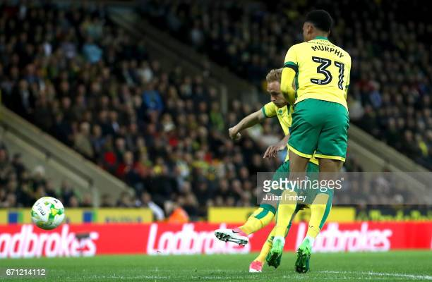 Alex Pritchard of Norwich City shoots on goal leading to an own goal scored by David Stockdale of Brighton and Hove Albion during the Sky Bet...