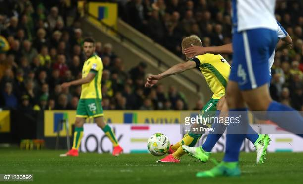 Alex Pritchard of Norwich City shoots on goal leading to the second own goal scored by David Stockdale of Brighton and Hove Albion during the Sky Bet...