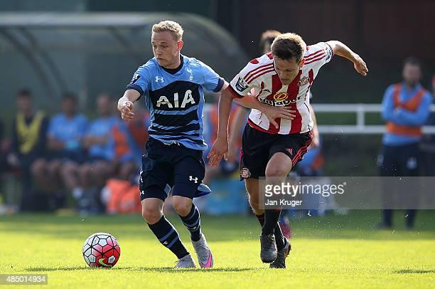 Alex Pritchard of Spurs holds off Joshua Robson of Sunderland during the Barclays U21 Premier League match between Sunderland U21 and Tottenham...