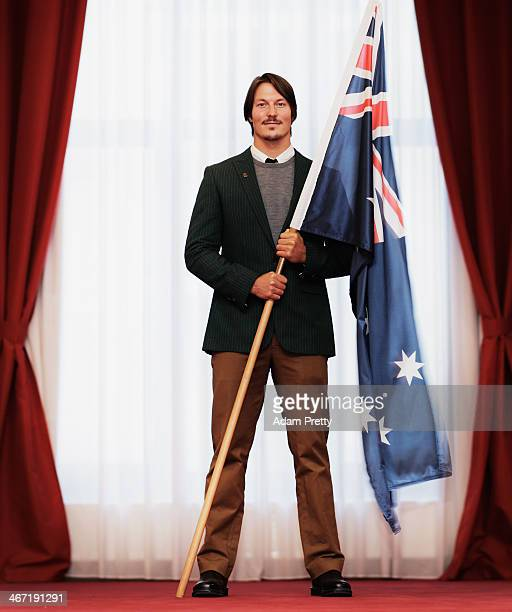 Alex Pullin of Australia poses with the Australian Flag after being announced as the Flag Bearer for Australia at the Sochi Olympics Opening Ceremony...