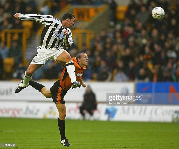 Alex Rae of Wolverhampton is challenged by Gary Speed of Newcastle during the FA Barclaycard Premiership match between Wolverhampton Wanderers and...