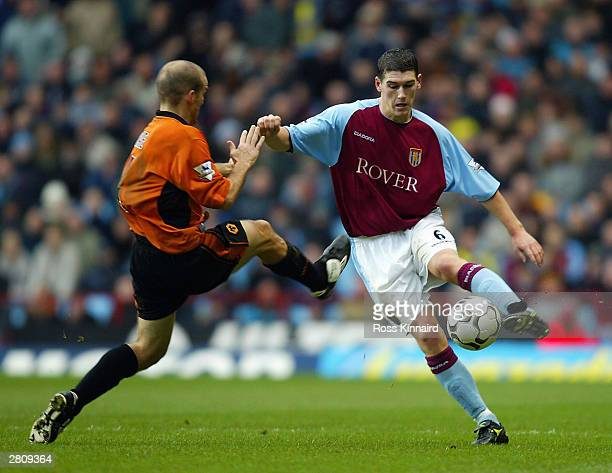 Alex Rae of Wolverhampton Wanderers tries to tackle Gareth Barry of Aston Villa during the FA Barclaycard Premiership match between Aston Villa and...