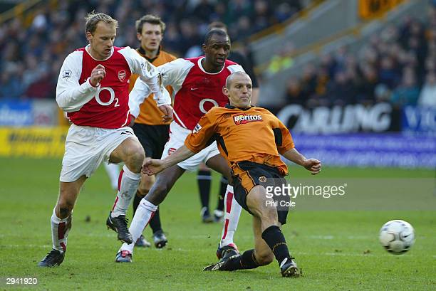 Alex Rae of Wolves is challenged by Dennis Bergkamp and Patrick Vieira of Arsenal during the FA Barclaycard Premiership match between Wolverhampton...