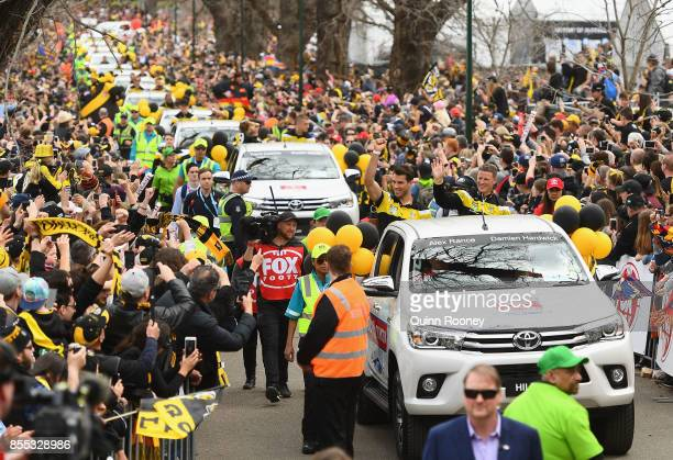 Alex Rance and Damien Hardwick of the Tigers wave to the crowd during the 2017 AFL Grand Final Parade ahead of the Grand Final between the Adelaide...