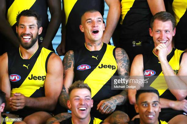 Alex Rance and Dustin Martin and Dylan Grimes of the Tigers react during the AFL Richmond Tigers team photo session at Punt Road Oval on February 22...
