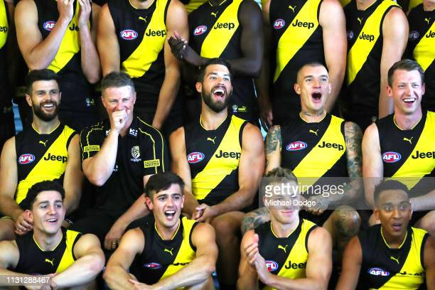 Alex Rance and Dustin Martin of the Tigers react during the AFL Richmond Tigers team photo session at Punt Road Oval on February 22 2019 in Melbourne...
