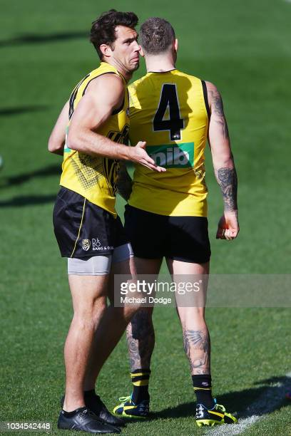 Alex Rance gestures behind Dustin Martin of the Tigers who trained seperately in the warm up during a Richmond Tigers AFL training session at Punt...