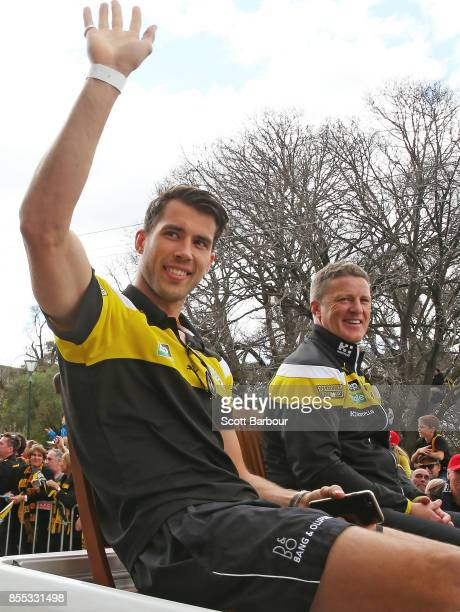 Alex Rance of the Tigers and Damien Hardwick coach of the Tigers wave to the crowd during the 2017 AFL Grand Final Parade ahead of the Grand Final...