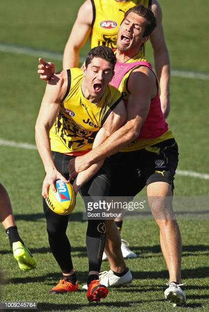 Alex Rance of the Tigers and Jason Castagna of the Tigers compete for the ball during a Richmond Tigers AFL training session at Punt Road Oval on...