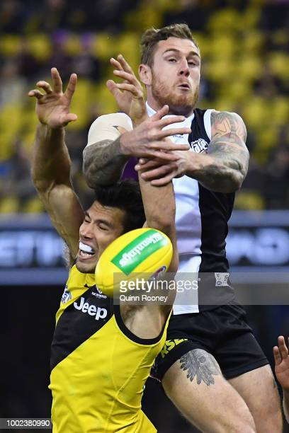 Alex Rance of the Tigers and Tim Membrey of the Saints compete for a mark during the round 18 AFL match between the St Kilda Saints and the Richmond...