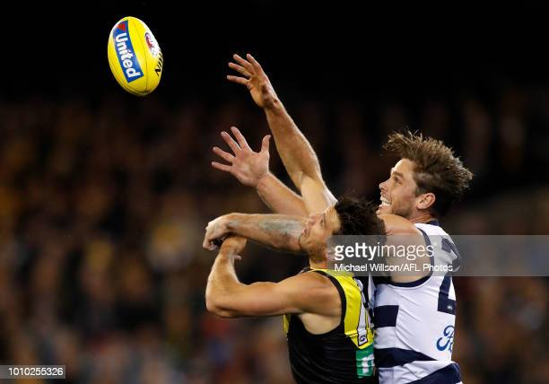Alex Rance of the Tigers and Tom Hawkins of the Cats compete for the ball during the 2018 AFL round 20 match between the Richmond Tigers and the...