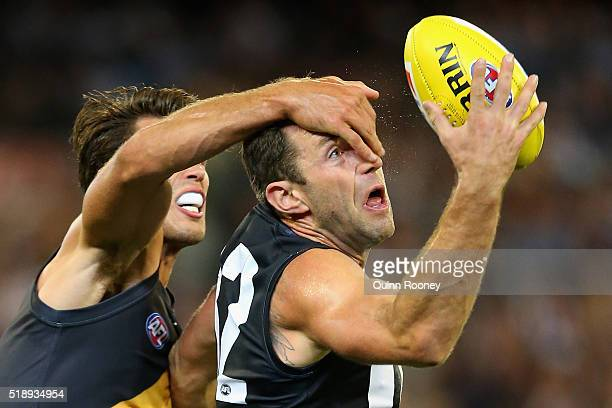 Alex Rance of the Tigers attempts to spoil Travis Cloke of the Magpies during the round two AFL match between the Collingwood Magpies and the...