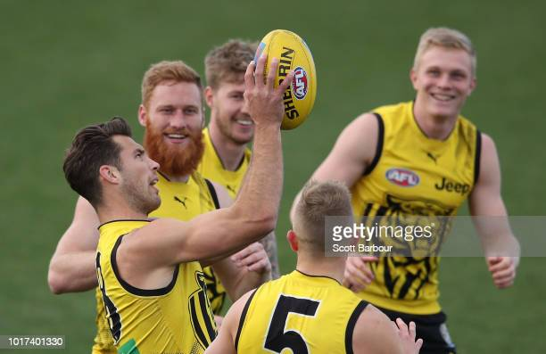 Reece Conca of the Tigers runs with the ball during a Richmond Tigers AFL training session at Punt Road Oval on August 16 2018 in Melbourne Australia