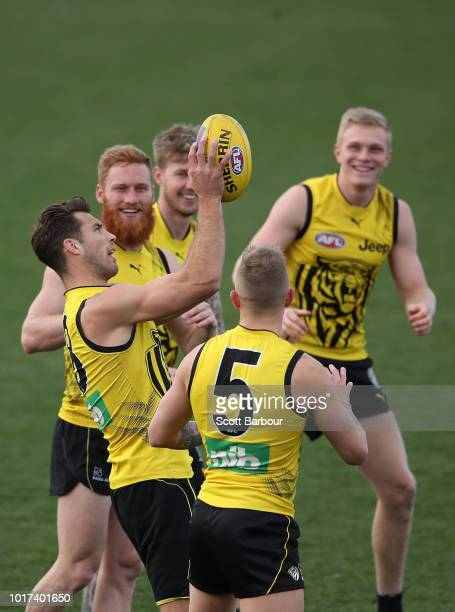 Alex Rance of the Tigers catches the ball as Ryan Garthwaite of the Tigers looks on during a Richmond Tigers AFL training session at Punt Road Oval...