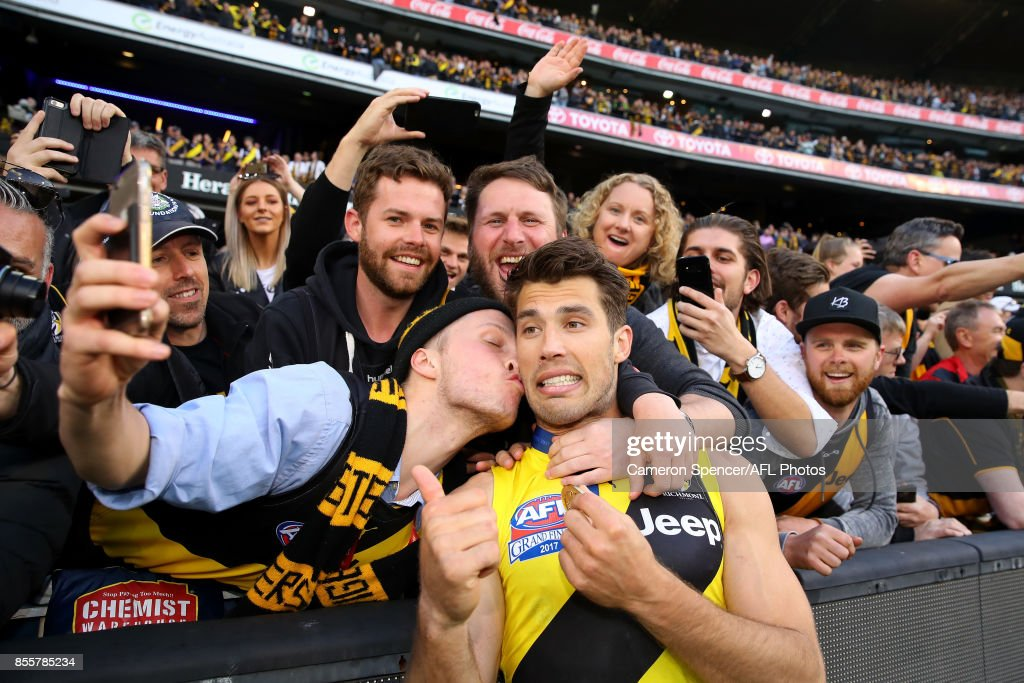 Alex Rance of the Tigers celebrates with fans after winning the 2017 AFL Grand Final match between the Adelaide Crows and the Richmond Tigers at Melbourne Cricket Ground on September 30, 2017 in Melbourne, Australia.