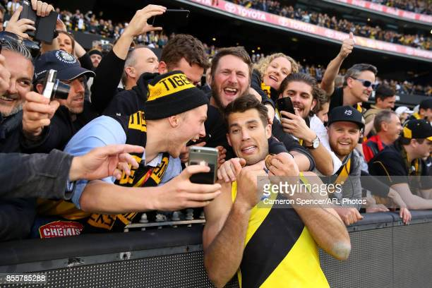 Alex Rance of the Tigers celebrates with fans after winning the 2017 AFL Grand Final match between the Adelaide Crows and the Richmond Tigers at...