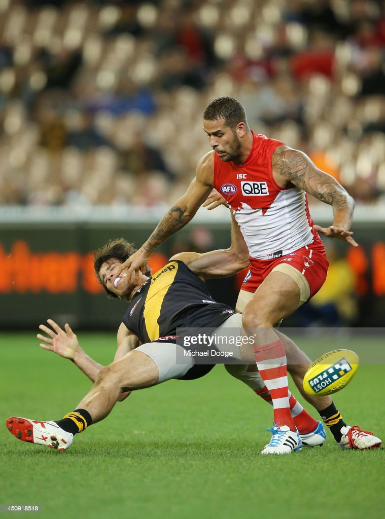 Alex Rance of the Tigers competes for the ball against Lance Franklin (R) of the Swans during the round 14 AFL match between the Richmond Tigers and the Sydney Swans at Melbourne Cricket Ground on June 20, 2014 in Melbourne, Australia.