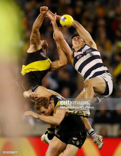 Alex Rance of the Tigers David Astbury of the Tigers and Jack Henry of the Cats compete for the ball during the 2018 AFL round 20 match between the...