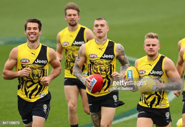 Alex Rance of the Tigers Dustin Martin of the Tigers and Brandon Ellis of the Tigers run during a Richmond Tigers AFL training session at Punt Road...
