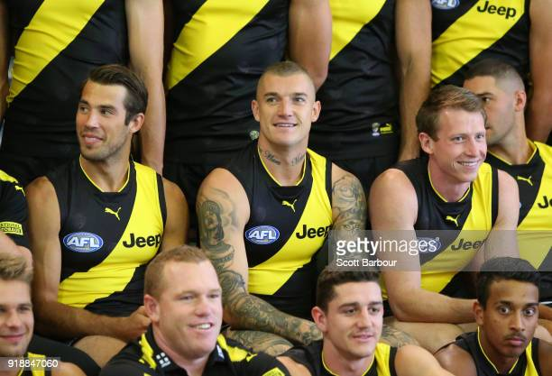 Alex Rance of the Tigers Dustin Martin of the Tigers and Dylan Grimes look on during a Richmond Tigers AFL team photo session at Punt Road Oval on...
