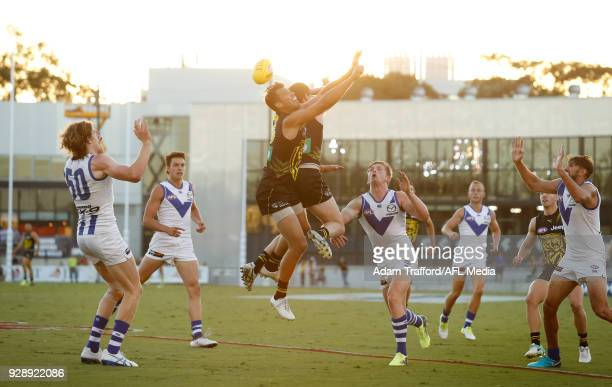 Alex Rance of the Tigers flies for the ball during the AFL 2018 JLT Community Series match between the Richmond Tigers and the North Melbourne...