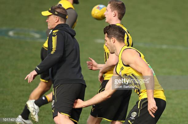 Alex Rance of the Tigers gestures towards Damien Hardwick coach of the Tigers during a Richmond Tigers AFL training session at Punt Road Oval on...