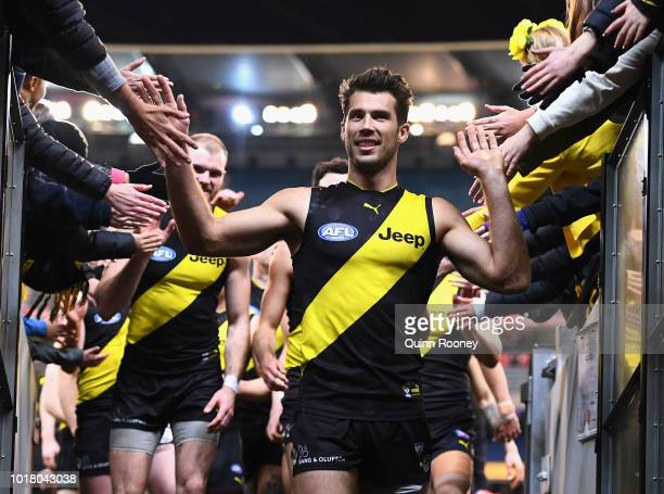 Alex Rance of the Tigers high fives fans after winning the round 22 AFL match between the Richmond Tigers and the Essendon Bombers at Melbourne...