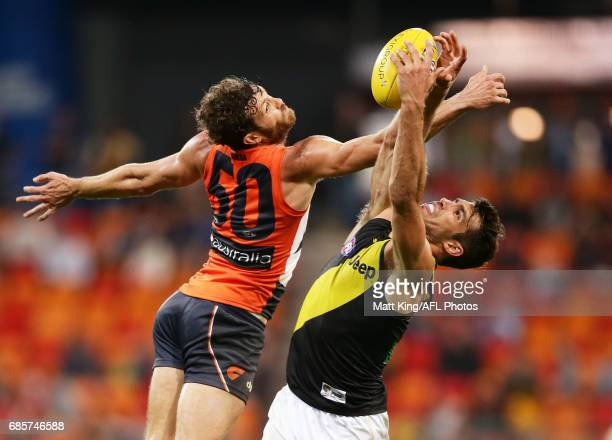Alex Rance of the Tigers is challenged by Sam Reid of the Giants during the round nine AFL match between the Greater Western Sydney Giants and the...