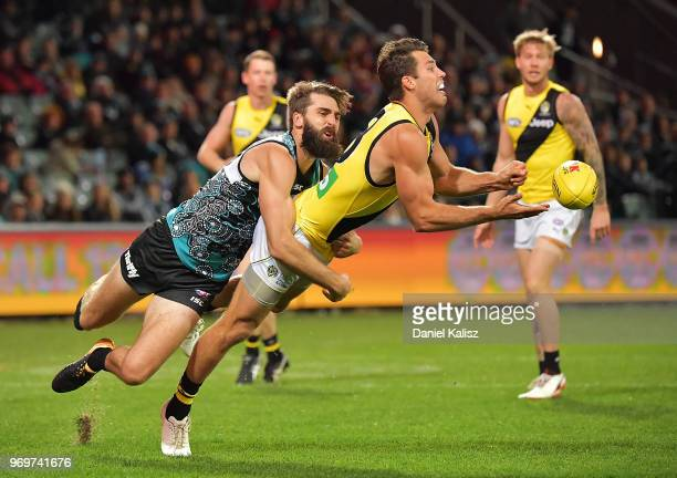 Alex Rance of the Tigers is tackled by Justin Westhoff of the Power during the round 12 AFL match between the Port Adelaide Power and the Richmond...