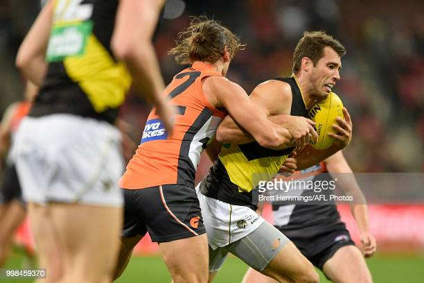 Alex Rance of the Tigers is tackled during the round 17 AFL match between the Greater Western Sydney Giants and the Richmond Tigers at Spotless...