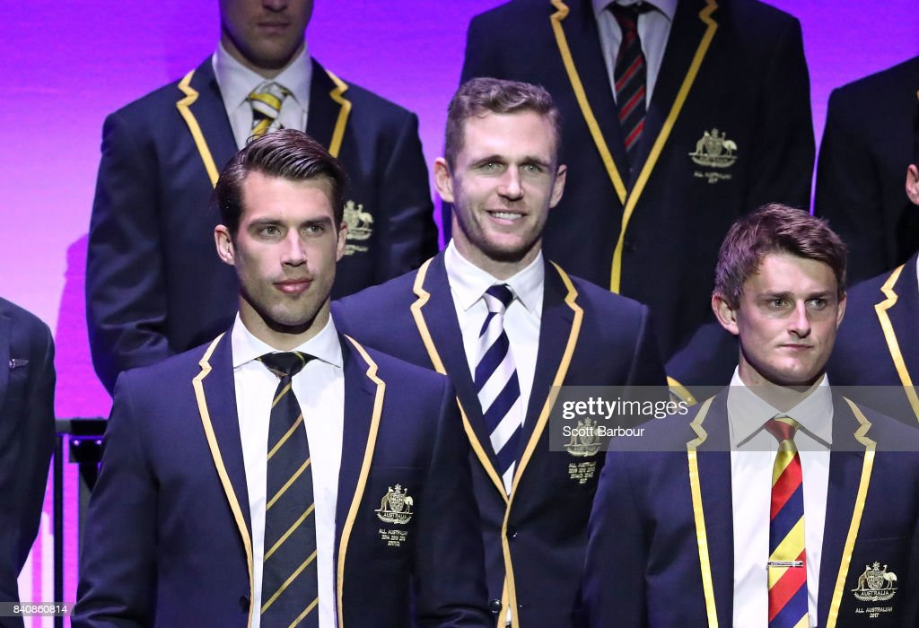 Alex Rance of the Tigers, Joel Selwood of the Cats and the AFL All Australian team pose on stage during the AFL All Australian team announcement at the Palais Theatre on August 30, 2017 in Melbourne, Australia.