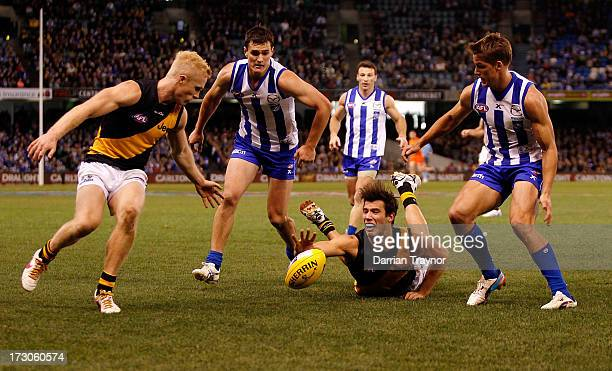 Alex Rance of the Tigers lunges for the ball during the round 15 AFL match between the North Melbourne Kangaroos and the Richmond Tigers at Etihad...