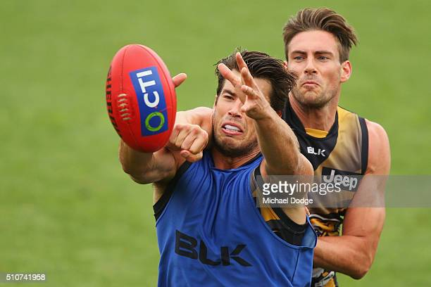 Alex Rance of the Tigers marks the ball against Shaun Hampson of the Tigers during a Richmond Tigers AFL media session at Punt Road Oval on February...